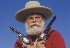 在历史再制定,加州期间,老西部枪手图画开枪 库存图片