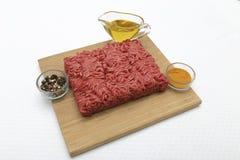 在厨师上的新鲜的牛肉 库存图片