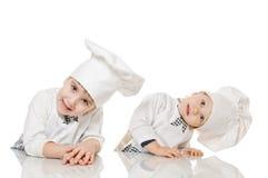在厨房里帮忙的仆人 免版税库存图片