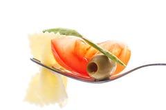 在叉子用蕃茄细面条 库存图片