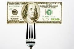 在叉子的一百元钞票 库存照片