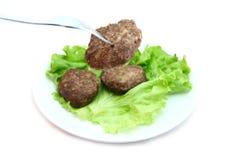 在叉子的小牛肉炸肉排 免版税图库摄影