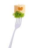 在叉子的干酪和沙拉 免版税库存图片