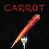 在叉子的红萝卜 免版税库存图片