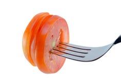 在叉子的蕃茄切片 库存照片