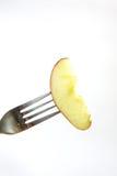 在叉子的Apple 免版税图库摄影