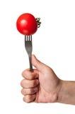在叉子stucked的完善的红色蕃茄 库存图片