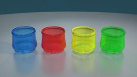 在反射性桌上的四块色的玻璃 库存照片