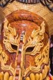 在发埃Ta Khon节日的木手工制造鬼魂面具,泰国 免版税库存照片