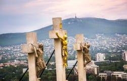 在受难象的耶稣基督十字架 免版税库存照片