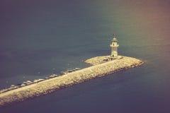 在口岸阿拉尼亚,土耳其的灯塔 钓鱼地中海净海运金枪鱼的偏差 免版税库存照片
