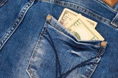 在口袋外面的票据棍子 免版税库存照片