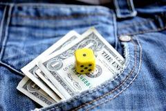 在口袋牛仔布和模子的一美元 免版税库存照片
