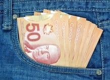 在口袋的加拿大金钱 图库摄影