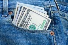 在口袋的美元金钱 免版税库存图片