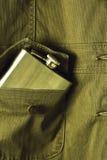 在口袋的金属烧瓶 免版税库存图片