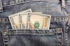 在口袋的金钱 免版税图库摄影