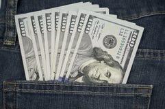 在口袋的$100张票据美国 图库摄影