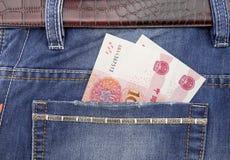 在口袋的RMB钞票 免版税库存图片