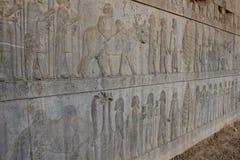 在古城波斯波利斯的墙壁上的符号安心 图库摄影