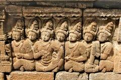 在古老婆罗浮屠寺庙的安心 免版税库存照片