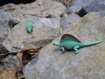 在古老石头的恐龙 库存照片
