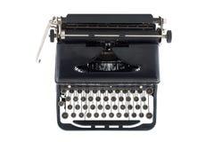 在古色古香的黑色打字机之上 库存图片