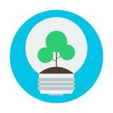 在可再造能源的电灯泡标志的概念树 图库摄影