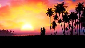 在史诗日落的浪漫夫妇剪影 图库摄影