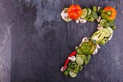 在右边在黑背景的计划的开胃菜特写镜头在第七 图库摄影