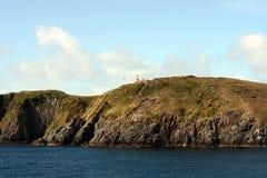 在合恩角的著名灯塔-火地群岛群岛的最南端的点,洗涤由德雷克的水 库存照片