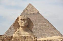 在吉萨棉和金字塔的狮身人面象 免版税图库摄影