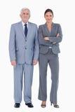 在同事旁边的成熟商人 免版税库存图片