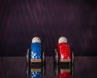 在同样方向发动的两辆玩具汽车 免版税库存图片