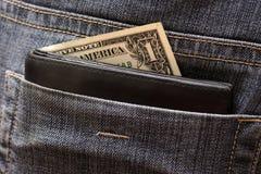 在后面口袋的一美元 免版税库存照片