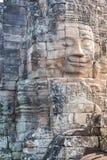 在吴哥城寺庙,选择聚焦的石头面孔 佛教凝思概念,举世闻名的旅行目的地,柬埔寨旅游业 免版税库存图片