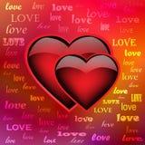 在呈虹彩背景的两热心心脏 免版税库存照片