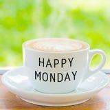 在咖啡杯的愉快的星期一 库存图片