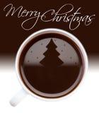 在咖啡表面的圣诞树图画 库存照片