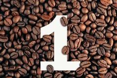 在咖啡豆背景概念的第一 库存照片