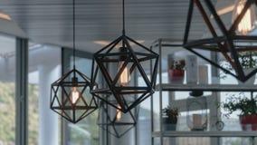 在咖啡馆的Handemade枝形吊灯 免版税库存照片