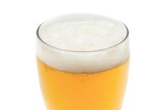 在品脱玻璃的琥珀色的啤酒 免版税库存图片