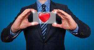 在商人前面的心脏-储蓄图象 库存照片