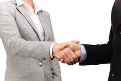 在商人和女商人之间的握手 图库摄影