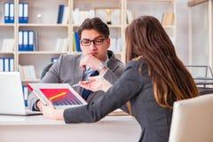 在商人和女实业家之间的业务会议 图库摄影