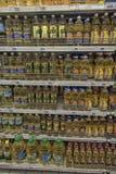在商店的架子的向日葵油 免版税库存图片