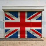 在商店门的大英国旗子 库存图片