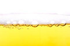 在啤酒的泡沫。 库存照片