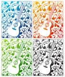 在四种颜色的吉他有装饰背景 库存照片