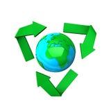 在回收符号世界附近 免版税图库摄影